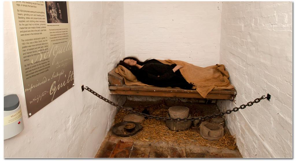Woman in prison cell bed
